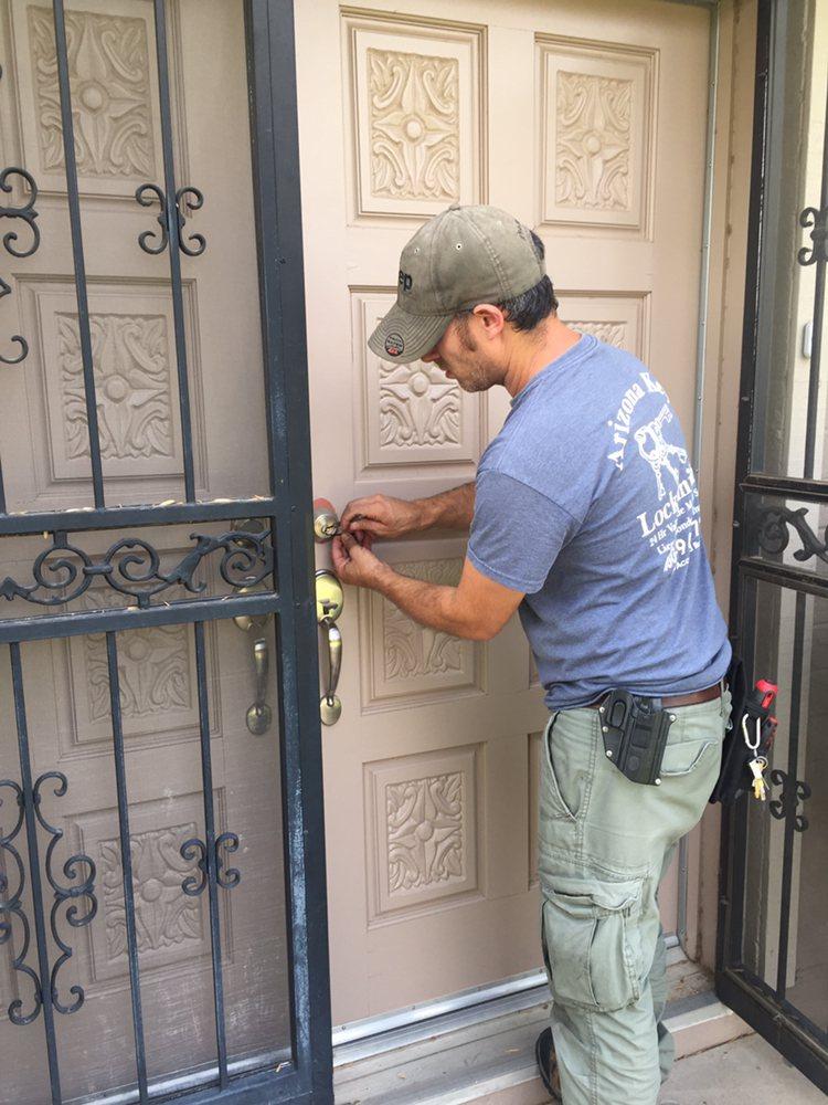Levi repairing a front door lock